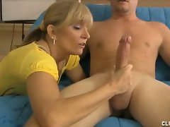 Neighborhood sexpot Mrs. Sexton loves jacking off the neighbor guys,...