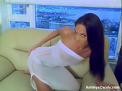 Ashley looks stunning posing on the couch in this sheer white dress....
