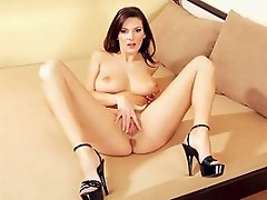 Pretty brunette Anita Queen takes her time in sizing up the dildo....