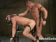 Tyler Saint fucks Luke Riley in bondage on a metal horse during a...