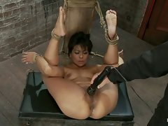 Sexy MILF Asian is bound, helpless and open.  Nothing she can do can...