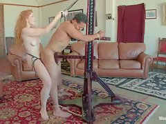 Beautiful redheaded bitch ties up slave boy and fucks his ass...