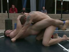 A chiseled, big-dicked stud takes on a big, beefy man's man in an...