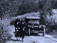 Two women walk down a road when a guy in a car comes along and offers...
