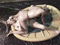 British lebians fight in a paddling pool of oil