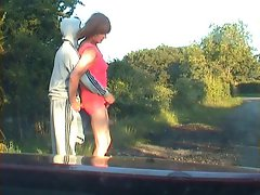 Zoe sucking  youth&,#039,s cock is with traffic and passers-by