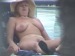 Nude Blonde Spreads Pussy Lips at Pool