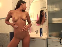 Zafira poses naked in front of the mirror in the