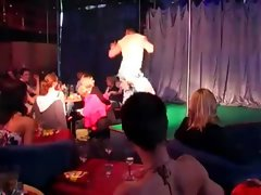 Party girl undressed by stripper
