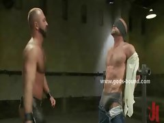 Two submissive gay men are suspended