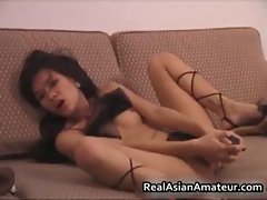 Foxy asian babe dildoing her slippery