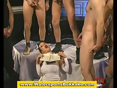 Watersport fetish slut drenched in piss and cum