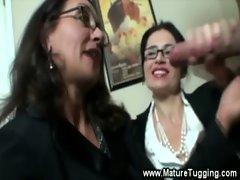 Horny mistresses get wet over a tug job