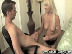 Sexy cougar tugs on a younger cock