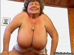 Thick grandma with giant tits gets