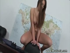 Pretty brunette rides a dildo saddle