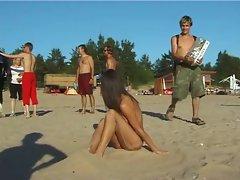 Nice looking fresh faced seductive teen plays at the beach nude