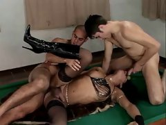 TS in knee boots gets fucked by 2 chaps