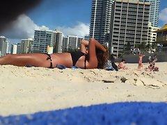 Spying on a lewd blondie sunbathing at beach - p1