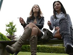 2 lezzy vixens smoking on bench in thigh high boots & hooters
