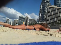 Spying on a attractive tempting blonde sunbathing at beach - p2