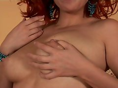 Jugs full of milk on a lovely redhead