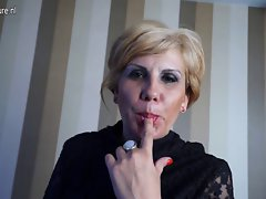 Blond attractive mature nympho mamma masturbating on the couch