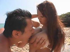 Big breasted Hitomi Tanaka at the beach