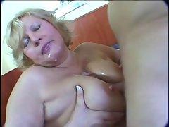 Plump blondie experienced masturbation on bed