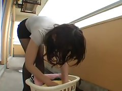 Sensual foreign lady gets upskirted on balcony
