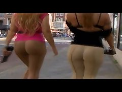 Two Lasses with Juicy round ass teasing on public